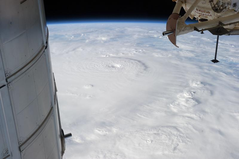 This photo provided by NASA and made from the International Space Station on Dec. 2, 2012, shows Typhoon Bopha moving toward the Philippines. Typhoon Bopha slammed into the Davao region of the Philippines early Tuesday, Dec. 4, killing at least seven people and forcing more than 50,000 to flee from inundated villages. (AP Photo/NASA)