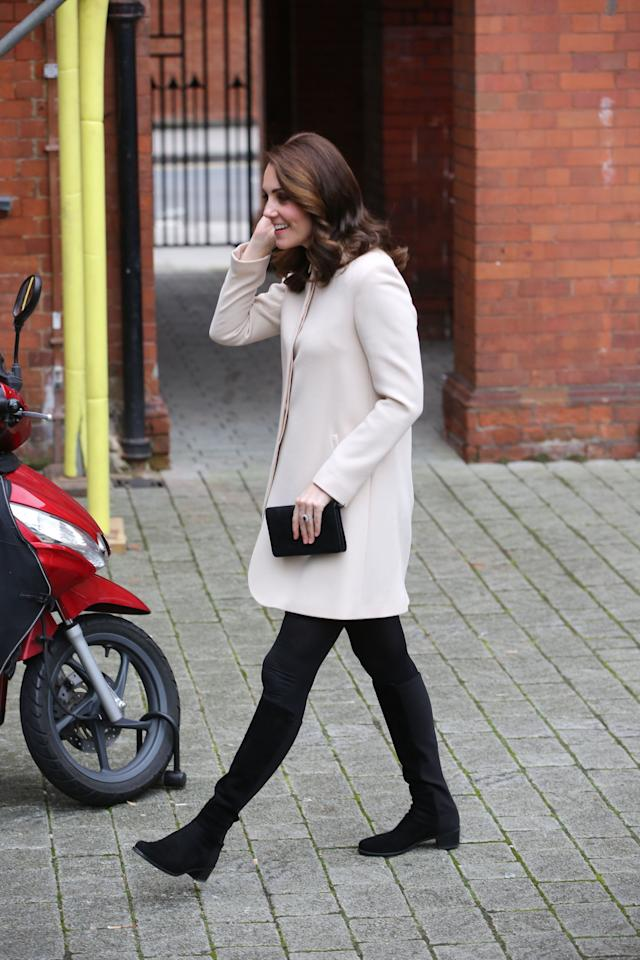 <p>A visit to the Hornsey Road Children's Centre in London on a chilly Tuesday called for opaque black tights and a warm coat dress. The Duchess picked out a cream coat from Goat for the occasion, paired with knee-high black boots. <em>[Photo: PA]</em> </p>