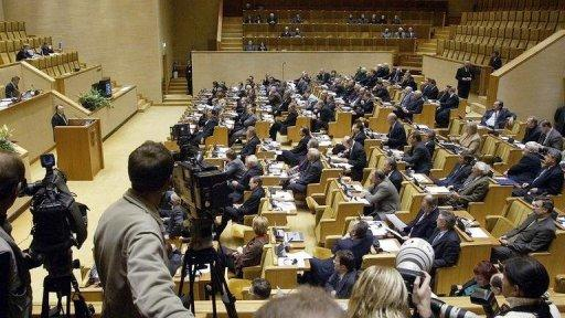 His death cuts to 85 the number of seats controlled in Lithuania's 141-member parliament by the incoming government
