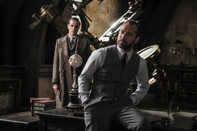 <p>In an effort to thwart Grindelwald's plans, Albus Dumbledore (Jude Law, right) enlists his former student Newt Scamander, unaware of the dangers that lie ahead. <br> (Photo: Jaap Buitendijk/Warner Bros.) </p>