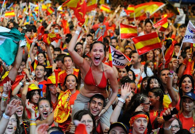 MADRID, SPAIN - JULY 01: Spain fans celebrates the UEFA EURO 2012 final match between Spain and Italy on a giant outdoor screen on Paseo de la Castellana on July 1, 2012 in Madrid, Spain. (Photo by Denis Doyle/Getty Images)