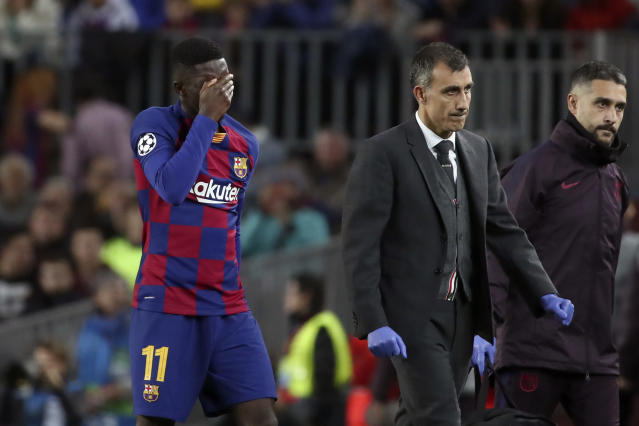 Barcelona's Ousmane Dembele leaves the field after getting injured during a Champions League group F soccer match between Barcelona and Borussia Dortmund at the Camp Nou stadium in Barcelona, Spain, Wednesday, Nov. 27, 2019. (AP Photo/Emilio Morenatti)