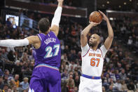 New York Knicks forward Taj Gibson (67) shoots over Utah Jazz center Rudy Gobert (27) during the first quarter of an NBA basketball game Wednesday, Jan. 8, 2020, in Salt Lake City. (AP Photo/Chris Nicoll)