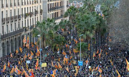 """FILE PHOTO: People fly """"Esteladas"""" (Catalan separatist flag) during a demonstration held by pro-independence associations in Barcelona, Spain March 11, 2018. REUTERS/Albert Gea"""