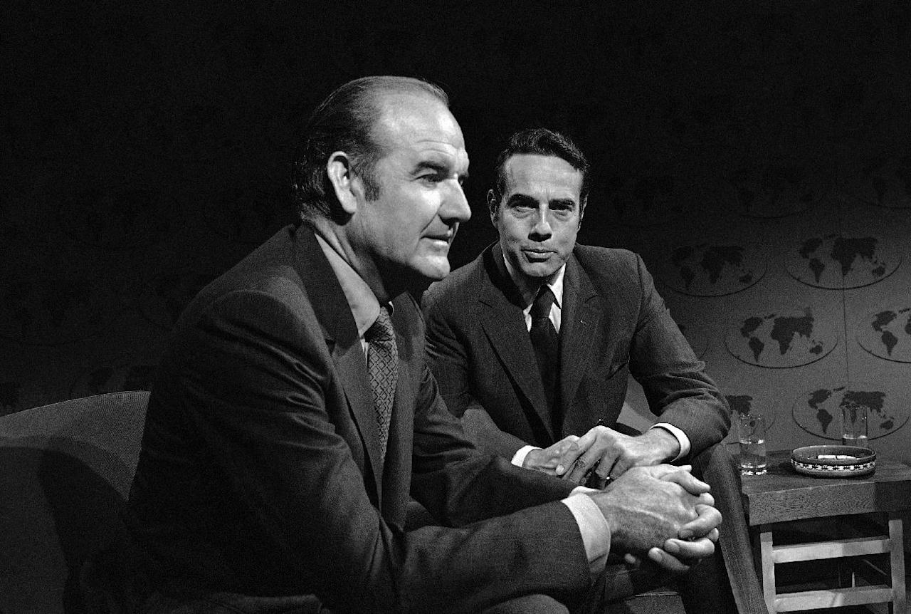 "FILE - In this Aug. 23, 1970 file photo, Sens. George McGovern, D-S.D. left, and Robert Dole, R-Kan., are interviewed on ABC's ""Issues and Answers"" in Washington. A family spokesman says, McGovern, the Democrat who lost to President Richard Nixon in 1972 in a historic landslide, has died at the age of 90. According to the spokesman, McGovern died Sunday, Oct. 21, 2012 at a hospice in Sioux Falls, surrounded by family and friends. (AP Photo/ABC Television, File)"