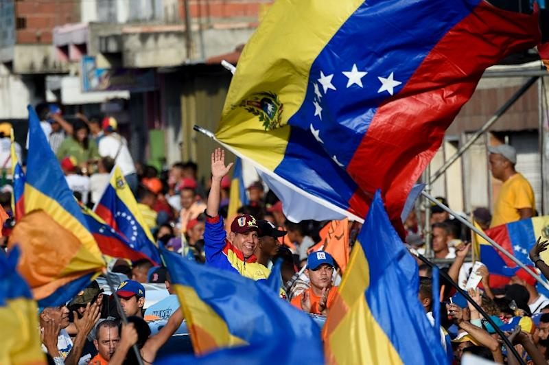 Rival Henri Falcon wore the yellow, blue and red of Venezuela's flag at his final rally in his western stronghold of Barquisimeto (AFP Photo/FEDERICO PARRA)