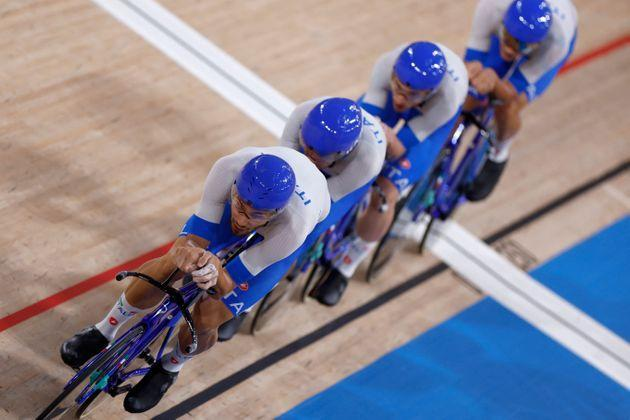 Italy's Filippo Ganna (L) leads the team as they setting the new world record during the first round heats of the men's track cycling team pursuit during the Tokyo 2020 Olympic Games at Izu Velodrome in Izu, Japan, on August 3, 2021. (Photo by Odd ANDERSEN / AFP) (Photo by ODD ANDERSEN/AFP via Getty Images) (Photo: ODD ANDERSEN via Getty Images)