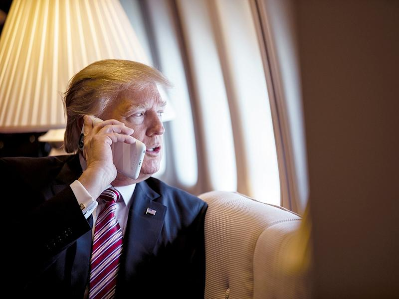 Donald Trump speaks on the phone aboard Air Force One during a flight to Philadelphia in 2017: The White House