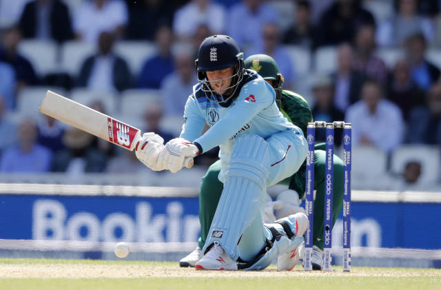 England's Joe Root plays a shot off the bowling of South Africa's Imran Tahir during their Cricket World Cup match at the Oval in London, Thursday, May 30, 2019. (AP Photo/Frank Augstein)