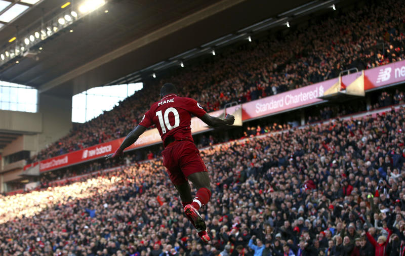Liverpool's Sadio Mane celebrates scoring his side's second goal of the game during the English Premier League soccer match between Liverpool and Cardiff City at Anfield in Liverpool England Saturday Oct. 27 2018