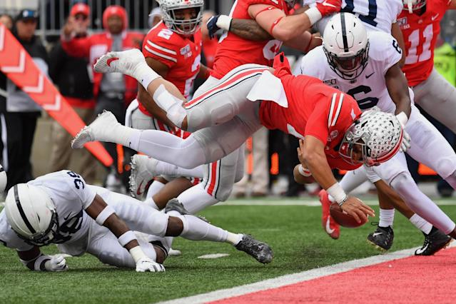 Ohio State QB Justin Fields fumbles the ball at the goal line after being upended by Penn State's Lamont Wade. (Jamie Sabau/Getty Images)