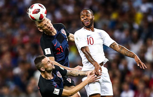 <p>Croatia's Marcelo Brozovic, Domagoj Vida, and Englands Raheem Sterling (L-R) in their 2018 FIFA World Cup semi-final match at Luzhniki Stadium. Valery Sharifulin/TASS (Photo by Valery Sharifulin\TASS via Getty Images) </p>