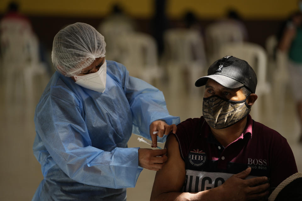 A healthcare worker administers a dose of the Moderna COVID-19 vaccine at a vaccination center in San Juan Sacatepequez, Guatemala, Thursday, July 15, 2021. About 1.5 million doses of the Moderna vaccine have been donated by the United States. (AP Photo/Moises Castillo)