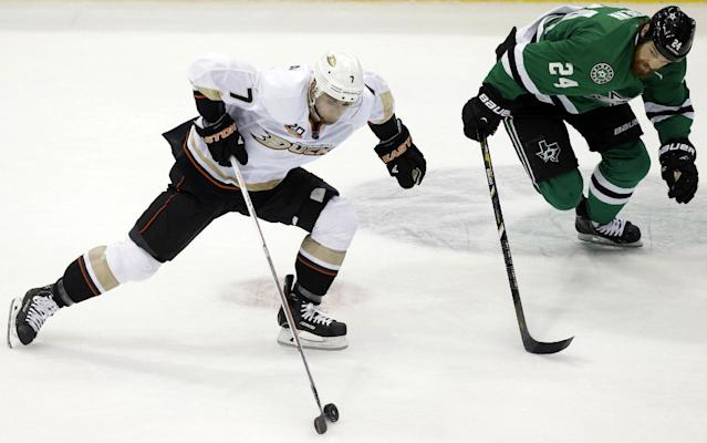 Anaheim Ducks center Andrew Cogliano (7) skates with the puck against Dallas Stars defenseman Jordie Benn (24) during the first period of Game 6 of a first-round NHL hockey playoff series in Dallas, Sunday, April 27, 2014. (AP Photo/LM Otero)