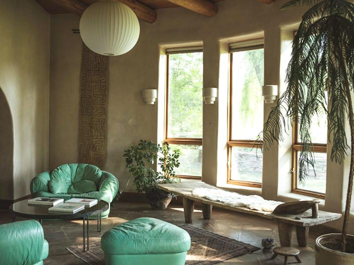 """With thoughtful, earth-toned interiors—curated by fashion designer Raquel Allegra—Many Feathers Ranch is a calming refuge tucked into a quiet canyon at the base of Taos Ski Valley. The 8,000-square-foot, six-bedroom ranch house sits between two flowing ponds on five acres, providing a perfectly tranquil backdrop for a long weekend away. The best part? Wrapping the enormous elevated porch off of the master suite in mosquito nets and bringing up to five beds out there for a night or two. After all, there's hardly a white noise machine more soothing than the sounds of hummingbirds and babbling brooks. $1500, Airbnb. <a href=""""https://www.airbnb.com/rooms/41438013?"""" rel=""""nofollow noopener"""" target=""""_blank"""" data-ylk=""""slk:Get it now!"""" class=""""link rapid-noclick-resp"""">Get it now!</a>"""