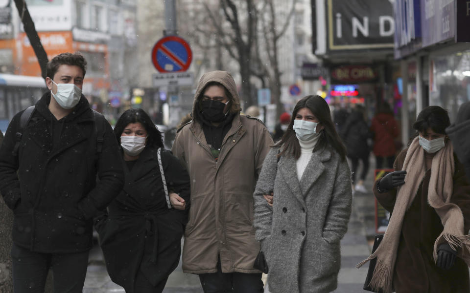 "People wearing masks to help protect against the spread of the coronavirus walk in Ankara, Turkey, Friday, March 26, 2021. Daily COVID-19 infections in Turkey surged above 26,000 on Friday, weeks after the government eased restrictions in dozens of provinces under a so-called ""controlled normalization"" program. (AP Photo/Burhan Ozbilici)"