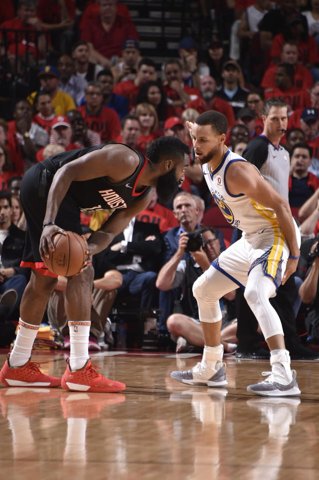 HOUSTON, TX - MAY 16: James Harden #13 of the Houston Rockets handles the ball against Stephen Curry #30 of the Golden State Warriors in Game Two of the Western Conference Finals of the 2018 NBA Playoffs on May 16, 2018 at the Toyota Center in Houston, Texas. (Photo by Bill Baptist/NBAE via Getty Images)