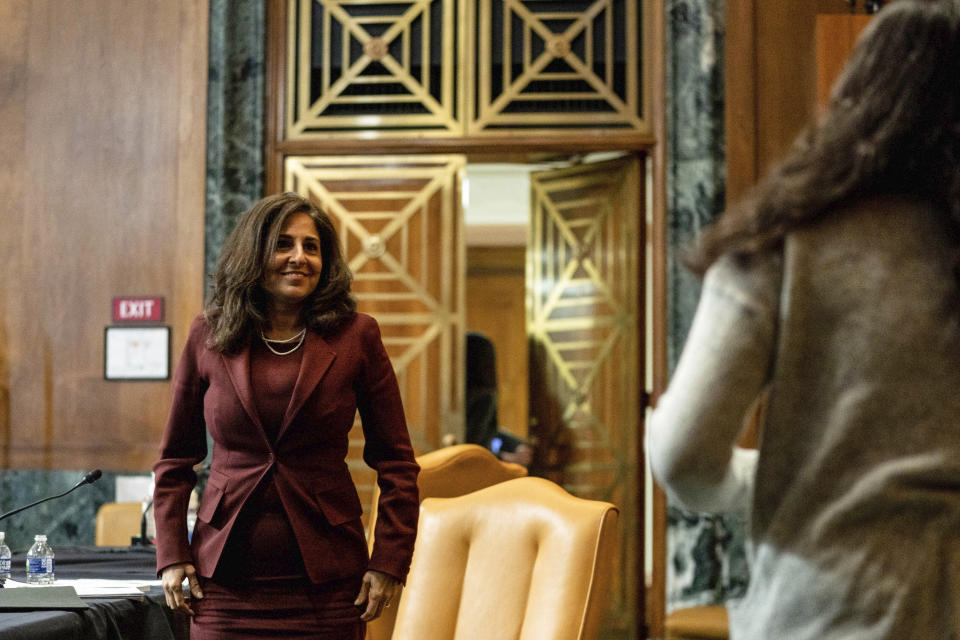 Neera Tanden, President Joe Biden's nominee for Director of the Office of Management and Budget (OMB), looks to her daughter at the end of a hearing before a Senate Committee on the Budget hearing on Capitol Hill in Washington, Wednesday, Feb. 10, 2021. (Anna Moneymaker/The New York Times via AP, Pool)