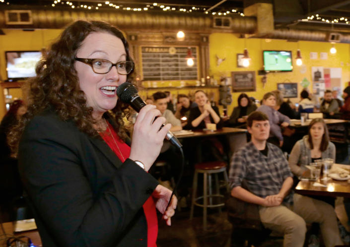 Kara Eastman, the Democrat challenging Bacon for his congressional seat, campaigns in Omaha, Neb. (AP Photo/Nati Harnik)