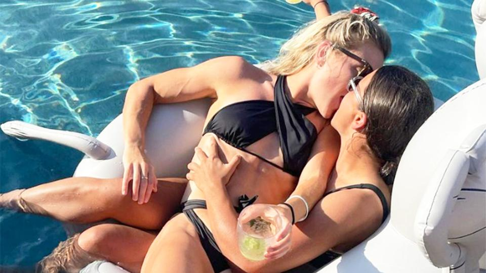 Seen here, Kristie Mewis and Sam Kerr share a kiss in a pool in a sizzling new Instagram post.