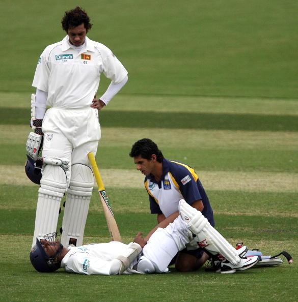 ADELAIDE, AUSTRALIA - OCTOBER 27:  Kumar Sangakkara of Sri Lanka is attended to by the team physio and team-mate Michael Vandort (L) during day one of the match between the Chairman's XI and Sri Lanka held at Adelaide Oval October 27, 2007 in Adeliade, Australia. (Photo by Simon Cross/Getty Images)