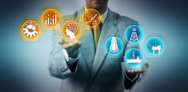 A man in a suit holding icons representing oil drilling and data.