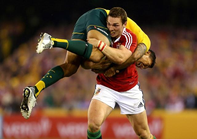 George North carries Israel Falaou on his shoulder after picking him up in a tackle during the British and Irish Lions 2013 tour of Australia. Warren Gatland's team lost 16-15 at the Etihad Stadium in Melbourne but won the Test series 2-1
