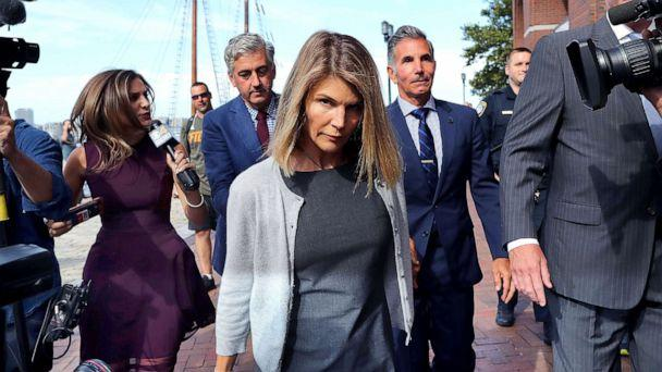 PHOTO: Lori Loughlin, center, and her husband Mossimo Giannulli, behind her at right, leave the John Joseph Moakley United States Courthouse in Boston on Aug. 27, 2019. (Boston Globe via Getty Images, FILE)
