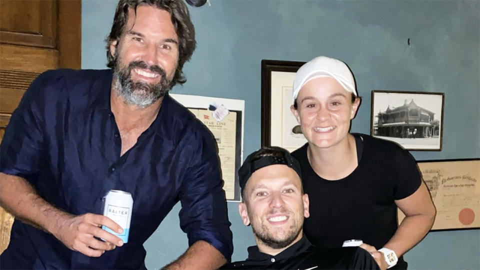 Pat Rafter, Dylan Alcott and Ash Barty, pictured here enjoying a beer.