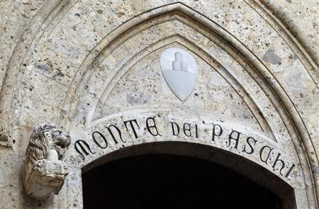 The Monte dei Paschi bank logo is seen on the main entrance of the bank's headquarters in Siena
