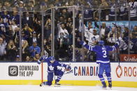 Toronto Maple Leafs center Auston Matthews (34) celebrates his goal with Justin Holl (3) during the first period of an NHL hockey game against the Tampa Bay Lightning on Thursday, Oct. 10, 2019, in Toronto. (Cole Burston/The Canadian Press via AP)