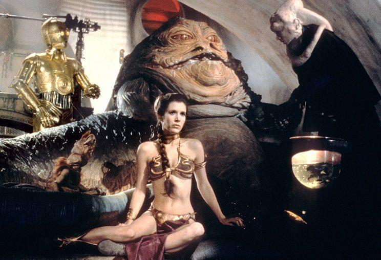 """<p>Here she is in the famous (and infamous) gold """"slave"""" bikini that has captured the imagination of fans and cosplayers ever since she appeared in it in 1983. (Photo: Everett Collection)</p>"""