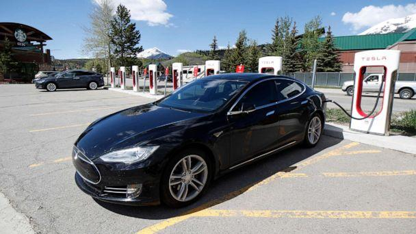 PHOTO: A Tesla Model S sedan charges at a supercharging station in Silverthorne, Colo. on June 8, 2019. (David Zalubowski/AP, FILE)