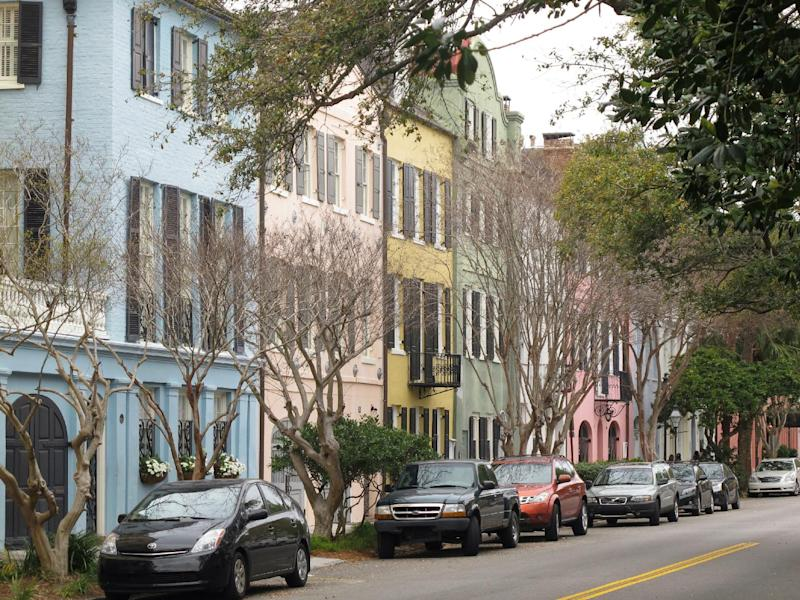 One of the most iconic vistas in Charleston, S.C., Rainbow Row, is seen in this March 11, 2013 photograph. It's free to walk through the city's historic district to see these and other historic homes.  (AP Photo/Bruce Smith)