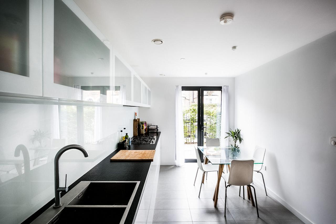 <p>The kitchen, with space for a dining table, is positioned towards the front of the house with doors that open to the front garden. </p>