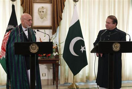 Afghan President Karzai speaks during a joint news conference as Pakistan's PM Sharif listens in Islamabad