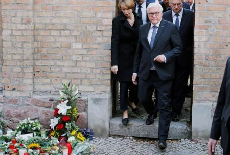 German President Frank-Walter Steinmeier, his wife Elke Budenbender and Saxony-Anhalt State Premier Reiner Haseloff leave the synagogue in Halle