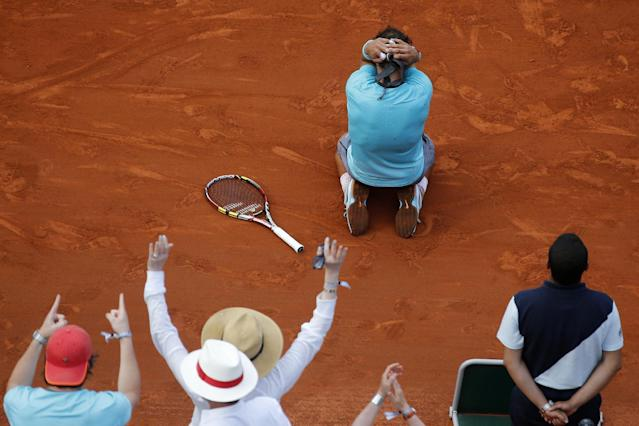 Spain's Rafael Nadal falls as he defeats Serbia's Novak Djokovic during their final match of the French Open tennis tournament at the Roland Garros stadium, in Paris, France, Sunday, June 8, 2014. Nadal won 3-6, 7-5; 6-2, 6-4. (AP Photo/David Vincent)