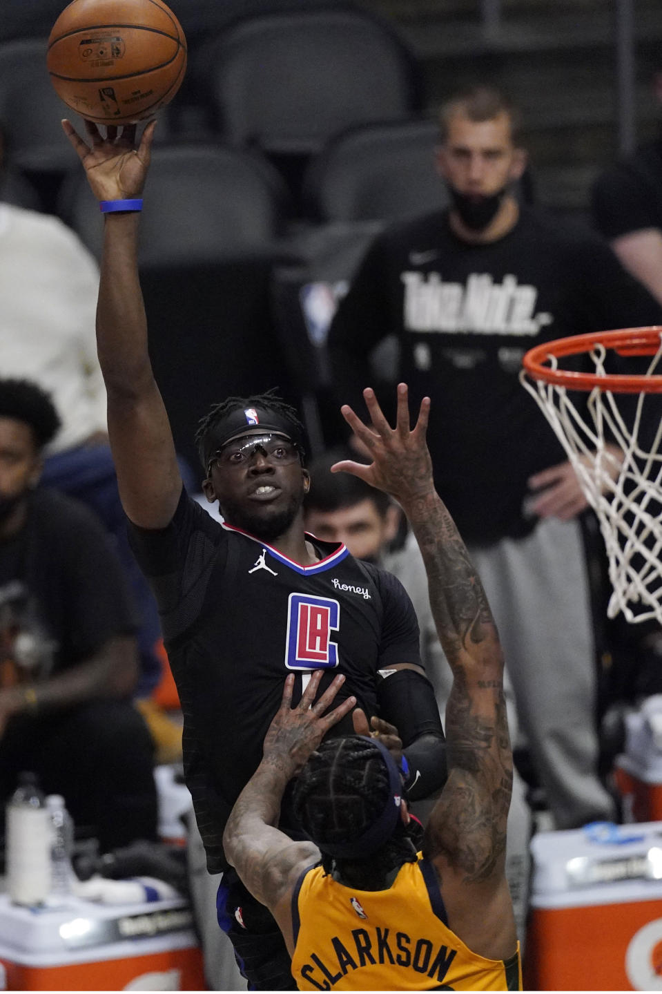 Los Angeles Clippers guard Reggie Jackson, left, shoots as Utah Jazz guard Jordan Clarkson defends during the first half in Game 4 of a second-round NBA basketball playoff series Monday, June 14, 2021, in Los Angeles. (AP Photo/Mark J. Terrill)