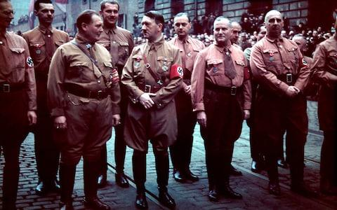 Top Nazi Party members march in remembrance of 1923 Beer Hall Putsch, Munich, Germany, November 9, 1938. Front row, from left, Friedrich Weber, Hermann Goering (1893 - 1946), Adolf Hitler (1889 - 1945), Ulrich Graf, and unidentified; back row, Alfred Rosenberg (1883 - 1946) (third from left) and unidentifieds. - Credit: Hugo Jaeger /The LIFE Picture Collection