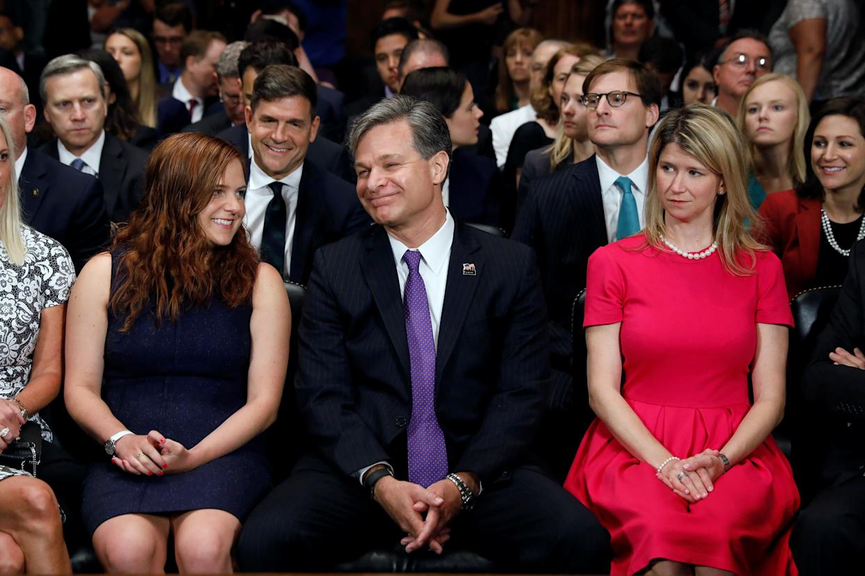 Christopher Wray is seated with his daughter Caroline, left, as he prepares to testify at a Senate Judiciary Committee confirmation hearing on his nomination to be the next FBI director on July 12, 2017.