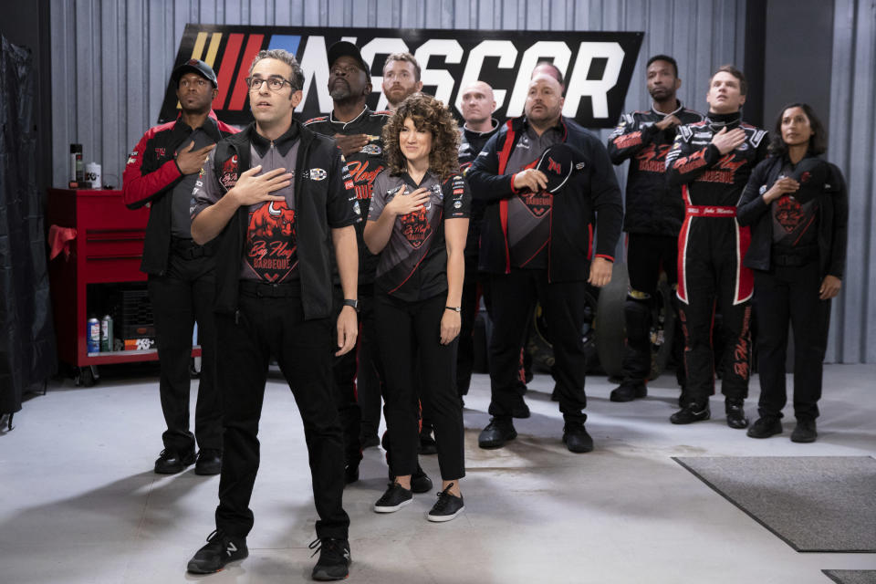 "This image released by Netflix shows Dan Ahdoot, foreground, Kevin James, fourth from right and Freddie Stroma, second right, in a scene from the comedy series ""The Crew."" (Eric Liebowitz/Netflix via AP)"