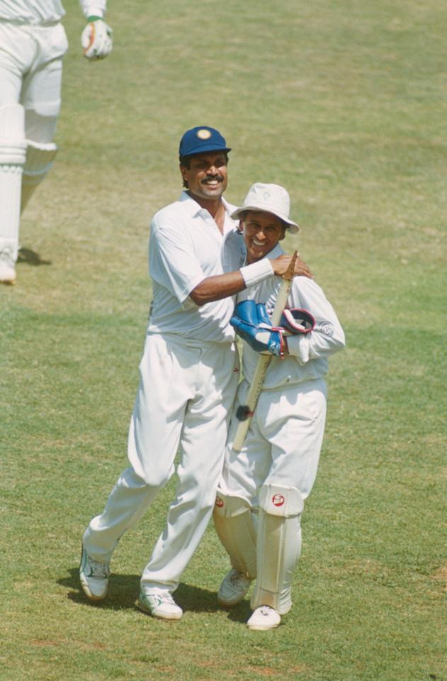 BOMBAY - FEBRUARY 23:  Kapil Dev and Kiran More of India celebrate victory during the Third Test match between India and England held on February 23, 1993 at the Wankhede Stadium, in Bombay, India. (Photo by Ben Radford/Getty Images)