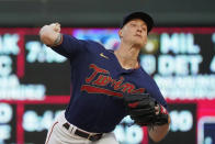Minnesota Twins pitcher Griffin Jax throws to a Cleveland Indians batter during the first inning of a baseball game Wednesday, Sept. 15, 2021, in Minneapolis. (AP Photo/Jim Mone)