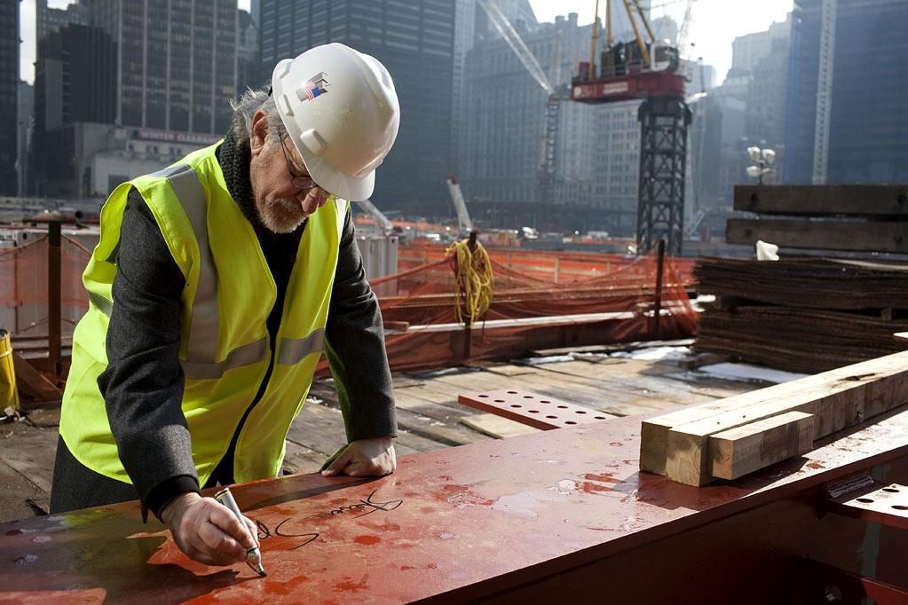"Mr. Steven Spielberg signs a beam ready to go up to the 20th floor during a tour of Ground Zero as part of the making of the show ""Rising: Rebuilding Ground Zero."""
