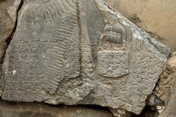 FILE - This Wednesday, Nov. 16, 2016 file photo shows a part of carved stone slabs which were destroyed by Islamic State group militants, at the ancient site of Nimrud some 19 miles (30 kilometers) southeast of Mosul, Iraq. One of the Mideast's most important archaeological sites, the nearly 3,000-year-old remains of an Assyrian capital had been a trove of ancient Mesopotamian art and, with hundreds of clay tablets, provided archaeologists a wealth of information on the era. (AP Photo/Hussein Malla, File)
