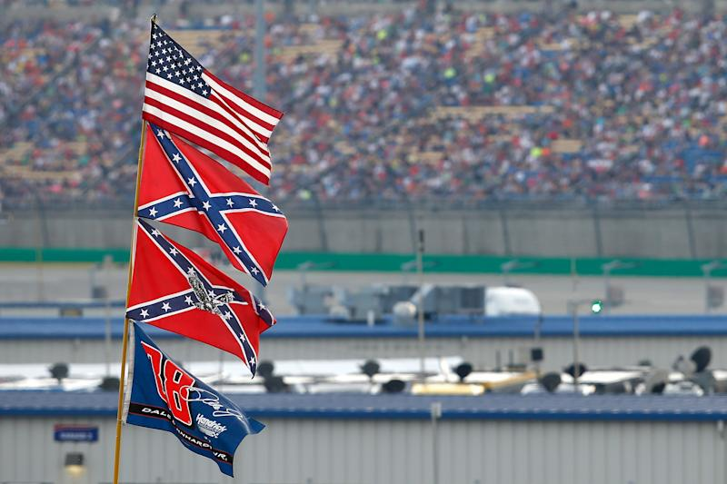 SPARTA, KY - JULY 11: A view of American and Confederate flags seen flying over the infield during the NASCAR Sprint Cup Series Quaker State 400 presented by Advance Auto Parts at Kentucky Speedway on July 11, 2015 in Sparta, Kentucky. (Photo by Todd Warshaw/Getty Images)