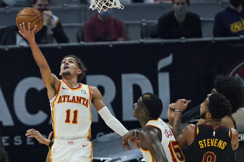 Atlanta Hawks' Trae Young (11) drives to the basket in the first half of an NBA basketball game against the Cleveland Cavaliers, Tuesday, Feb. 23, 2021, in Cleveland. (AP Photo/Tony Dejak)