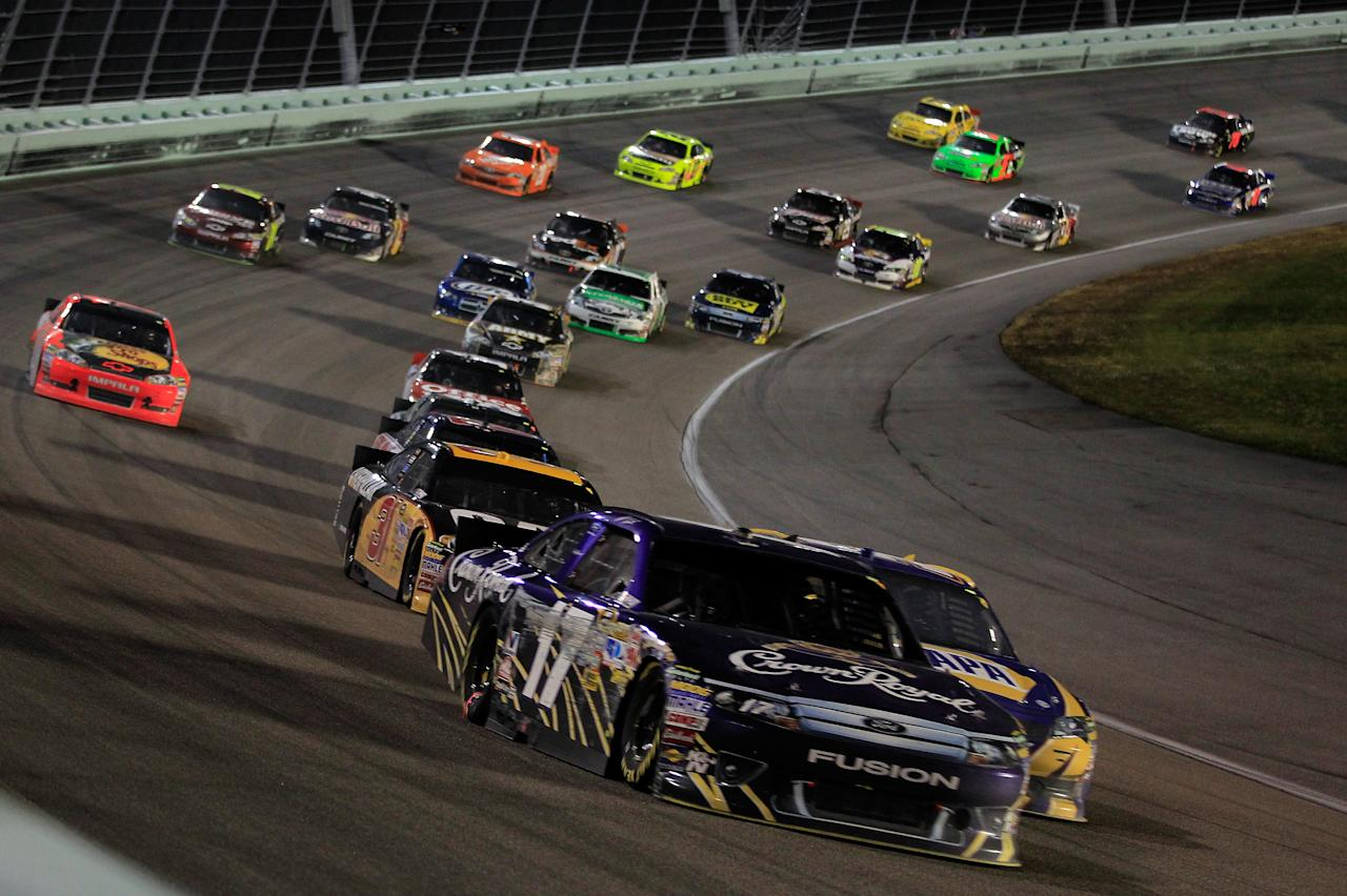 HOMESTEAD, FL - NOVEMBER 20:  Matt Kenseth, driver of the #17 Crown Royal Ford, leads the field during the NASCAR Sprint Cup Series Ford 400 at Homestead-Miami Speedway on November 20, 2011 in Homestead, Florida.  (Photo by Chris Trotman/Getty Images for NASCAR)