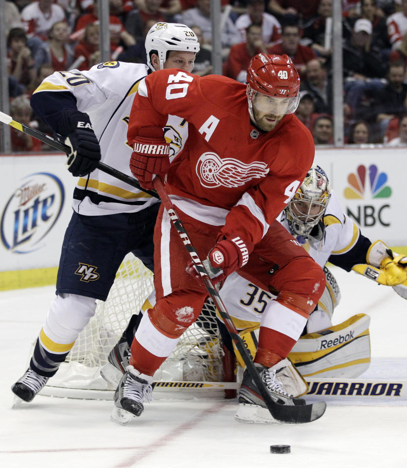Detroit Red Wings center Henrik Zetterberg (40), of Sweden, controls the puck in front of Nashville Predators defenseman Ryan Suter (20) during the first period of Game 3 of an NHL hockey Stanley Cup first-round playoff series in Detroit, Sunday, April 15, 2012. (AP Photo/Carlos Osorio)
